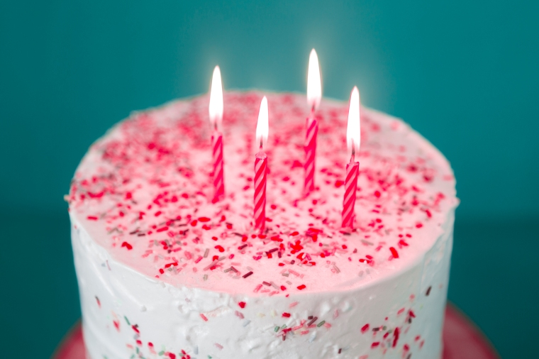 birthday-cake-with-lit-candles